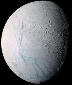 """Enceladus. False  color mosaic of one of Saturn's moons (2005-07-14). It's made up of images taken at various wavelengths from ultraviolet to infrared. (Credit: NASA/JPL/Space Science Institute) Mona Evans, """"Galactic Winter Games"""" http://www.bellaonline.com/articles/art182620.asp"""