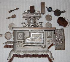Antique salesmans sample miniature Royal Stove with accessories.
