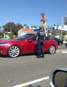 """Naked Man on Top of Tesla Stops Traffic on PCH - According to authorities: the man had a possible """"meltdown or psychiatric episode or was on a controlled substance."""" -  Duh!"""