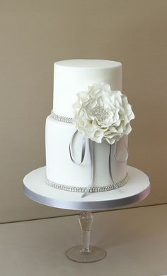Beautiful two tier wedding cake - Fashionable Society Events adores this simple creation. #weddingplanner #weddingstylist