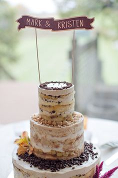 naked cake topped with cute banner and chocolate chips from wedding by Lollipops and Lemondrops Events http://www.popsanddropsevents.com/