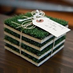 Sports Turf Coasters, the item is sold out; however, it looks easy enough to make, a bit of astro turf, tiles and felt pads on the bottom.