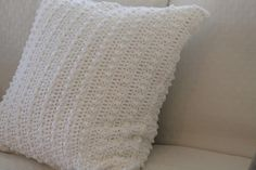 These pillows have a clean, romantic aesthetic. The pattern is built on a simple principle; periodically, a triple crochet stitch is squished within a single crochet row. The end effect is stunning - these pillows look like they're beaded!