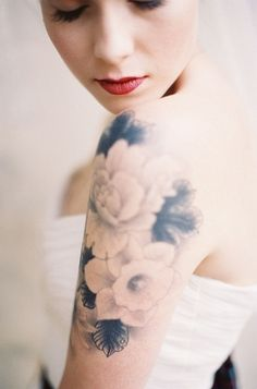 White & black floral tattoo