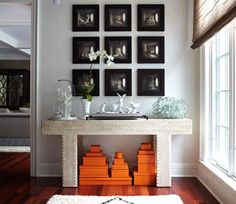 Decorating and Design Tips from Kara Mann | Traditional Home...Hermes Boxes make a statement