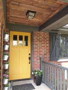 Front Porch Pallet Wood Ceiling. Yellow door.