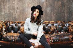 gray sweater + black hat