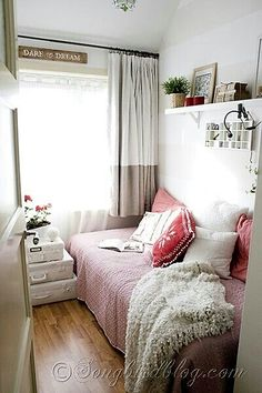 with a small space, turn your bed into a sitting area too with throw pillows