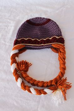 Handmade crochet Princess Anna inspired hat from Frozen with long thick braids. Disney inspired hat.