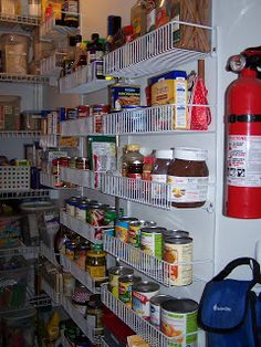 Storing canned goods and other products on wall shelves in your pantry {featured on Home Storage Solutions 101}