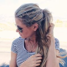 Upgrade your standard half-up 'do by weaving in a few small braids.