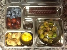 """Grapes, blueberries, fruit rope, """"monster eggs"""" (Brussel sprouts), turkey and mustard, and 2 choc covered almonds!"""