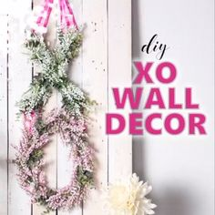 Add a little love to your home decor with this pretty pink and white XO Valentines wall decor idea. A lovely decoration for a wedding or shower as well. #valentinesday #valentinesdaydecor #homedecor #valentinewreaths #valentine #adultcrafts #DIYwreath #springcrafts