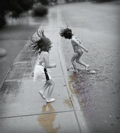 Puddle jumping & playing outside in the warm, summer rain...