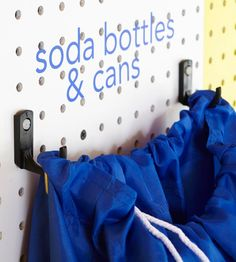 Taking cans and bottles to your return center is less of a hassle when you dedicate a bag or other container to the job. Hang the bag from a pair of hooks (using two hooks ensures stability) and add a label so everyone knows what items can be returned for a deposit.