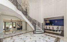 2-story Foyer w/ Floating Staircase and inlaid marble floor