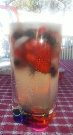Red, white  blue drink. White wine, peach vodka,  triple sec  lemon juice. (Strawberries  blueberries)