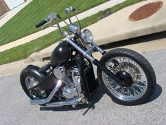 Honda Shadow vt600 custom in flat black with right angle apes and front rim hub cup