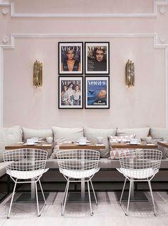 Vogue Cafe Printemps Haussman Paris Catherine Deneuve Hitchcock cover prints seating Bertoia chairs brass sconces