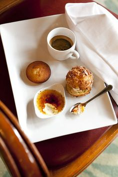 As the French spend less time at lunch and favor healthier fare, more opt for the sweet shortcut of an espresso served on the same plate with a few bite-size desserts. Shown, a café gourmand at La Fermette Marbeuf includes creme bruleé, a financier, and a profiterole.