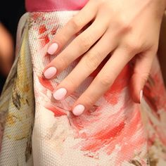 Nail artist @julieknailsnyc used 'fiji', a gorgeous creamy pale pink, at the Naeem Khan show. #essieNYFW #essielook