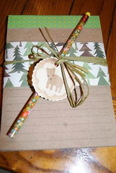 our favors.....notepad wrapped with forest themed scrapbook paper, tied with green raffia ribbon, and a printable forest animal (free printable via childreninspiredesign.com blog)