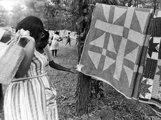 Members of the Freedom Quilting Bee display their quilts, circa 1966.