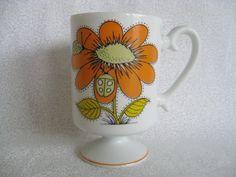 Orange flower mug/vintage mug/flower and ladybugs mug/orange and yellow glass cup. $6.00, via Etsy.