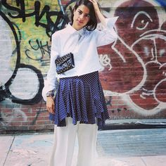 Man Repeller wearing the Jimmy Choo Candy Clutch