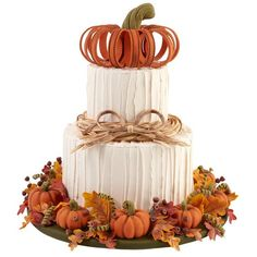 Impress your guests this fall with a towering, pumpkin-topped, two-tier cake. It's great for Halloween, Thanksgiving or any fall celebration. Use Wilton Ready-To-Use Rolled Fondant to create all the realistic-looking, harvest-inspired decorations.