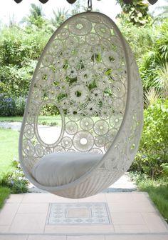 white hanging pod chair -