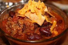 Crockpot Beef Chili with Beans...added extra beans, super simple chili, not too spicy or salty. :)