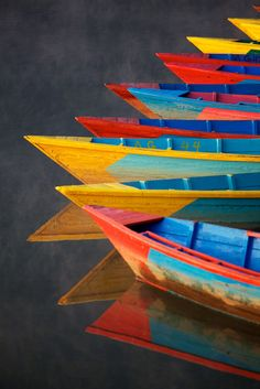 water, primary colors, wooden boats, rainbows, brushes
