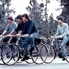 The Beatles riding bikes
