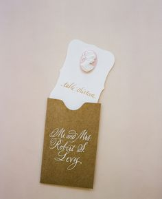 Escort cards. Calligraphy by Elizabeth Porcher Jones. Photo by A Bryan Photo.