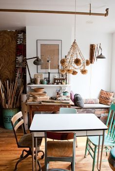 art studio eclectic.  industrial lamps, 50s kitchen table, mixed school house chairs