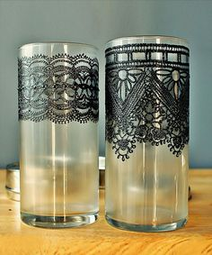 These vases are painted in henna–like detail on frosted glass.