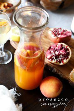 Prosecco Sangria {Prosecco + Brandy + Peach + Apricot Nectar} // JulieBlanner.com - #Prosecco #Sangria #Bubbly #Brunch