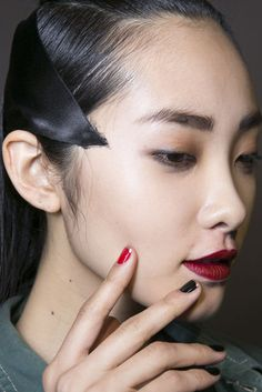 Models wore a black, gold-tipped French manicure at Alexis Mabille with a fiery accent nail to set it off.