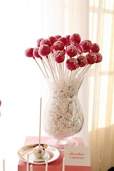 display cake pops (caterers can use cookie cutter shapes to create cake pops for each holiday) for Valentine's Day have caterer make heart shaped cake pops
