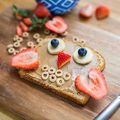 Breakfast Owls! Slice of toast, peanut butter, sliced strawberry wings, bananas slices and blueberries.