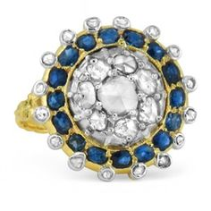 $1,650 A stunning Edwardian design, this highly detailed ring features twenty-three diamonds and sixteen enchanting sapphires set in a large circular pattern. An engraved band of rich yellow gold finishes off this gorgeous ring