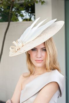 Stunning ivory feathered hat