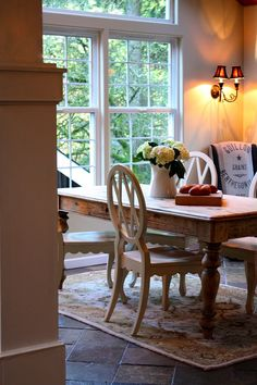 Love the dining roome table and white chairs!