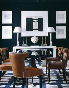 Dramatic dining room.  Leather + moody walls   Luis Bustamante