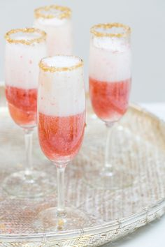 An easy twist, add a little strawberry puree to Champagne!