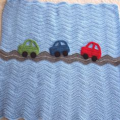 Crochet Cars Ripple Blanket  - A Baby Boy Ripple Afghan in Blue and Gray with Green, Blue, Red Car Appliques - 31 x 31 Size. $60.00, via Etsy.