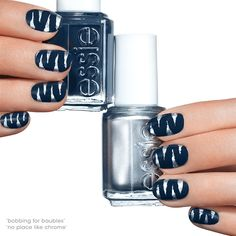 This tantalizing dark blue nail art will have you out on the prowl.