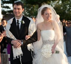 Chelsea Clinton wed Marc Mezvinsky on July 31, 2010 at Astor Courts in Rhinebeck, N.Y. Chelsea wore a beautiful custom designed gown by Vera Wang that was based on the Diana dress. She accessorized with a Vera Wang crystal belt and a beaming smile! Vera Wang gowns are sold at The Bridal Salon at Saks Jandel.