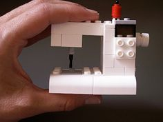 suchity such: LEGO sewing machine tutorial    http://suchitysuch.blogspot.com/2012/05/lego-sewing-machine-tutorial.html#